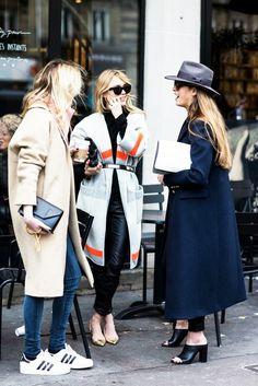 Women conversing outside a coffee shop // street style, lifestyle
