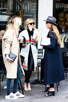 Women conversing outside a coffee shop // street style, lifestyle
