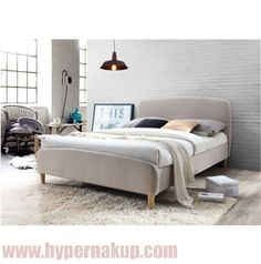Moderná posteľ s vysokým čelom a lamelovým roštom,  prevedenie: látka béžová + drevené nohy (farba dub),  rozmery (ŠxDxV): 189x214x98,5 cm, spanie: 180x200 cm.  Možnosť dokúpenia matraca o rozmere 180x200 cm na základe našej ponuky.  Hmotnosť: 58 kg   Manželská posteľ s roštom, 180x200, béžová látka/ drevené nohy, RUPA