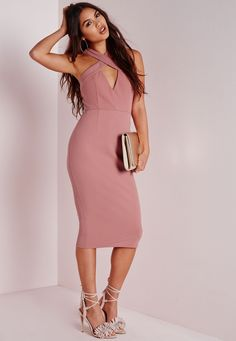 Channel major chic vibes in this rose pink midi dress. With fierce cross front neckline this dress will give you a standout silhouette. Team with black lace up heels and box clutch for a luxe finish.