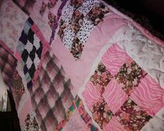Aibelle's quilt. Aibelle is another of my oldest sister's grandchildren. The bottom right corner is a piece of the same fabric from her Grandma's quilt