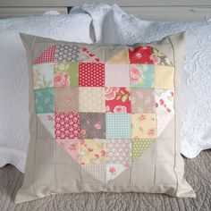 Patchwork heart pillow in Strawberry Fields Revisited by Fig Tree & Company for Moda, with Moda Cross Weave in Sand. Sewn by Carried Away Quilting.