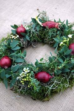green wreath with red onions