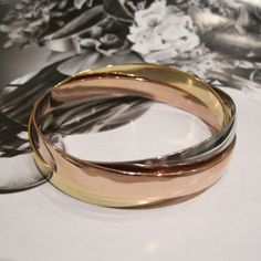 Interlocking Bangles - Touch of Modern I love the combining of the different tones.
