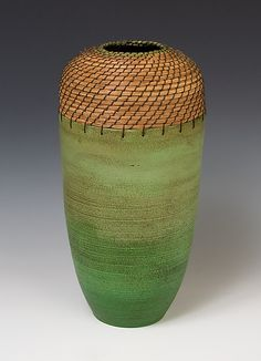 This vase by Hannie Goldgewicht is deceptively simple in shape, understating all the complex work and coloring that goes into it.