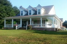 Comfortable southern country cottage house with wrap around porch. My dream house!