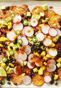 Give nachos a mucho-healthy boost by using crispy baked sweet potato rounds instead of tortilla chips and piling them with crunchy radishes, tangy mango and creamy avocado, as blogger Jeanine Donofrio does in this recipe from her forthcoming The Love & Lemons Cookbook.
