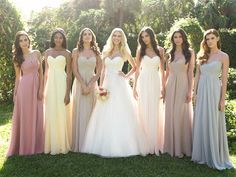 Mismatched Bridesmaid Dresses. So cute! The same styles but different colors!