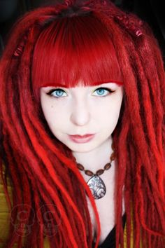 I love the contrast of her hair and bright blue eyes.