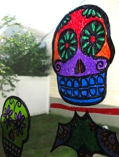 Human Body science kit - Dia de los Muertos sun catchers from old overhead plastic pages and sharpies.
