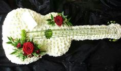 Order Guitar/Cushions,Roses flower arrangement from Gene's Floral Creations, your local Brooklyn Park, MD florist. Send Guitar/Cushions,Roses floral arrangement throughout Brooklyn Park and surrounding areas. Arrangements Funéraires, Funeral Floral Arrangements, Deco Floral, Arte Floral, Floral Design, Teodoro E Sampaio, Funeral Sprays, Fleur Design, Casket Sprays