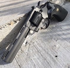 Colt Python 357, Revolver, tungsten, graphite black. guns, weapons, self defense, protection, 2nd amendment, America, firearms, munitions #guns #weapons Loading that magazine is a pain! Get your Magazine speedloader today! http://www.amazon.com/shops/raeind