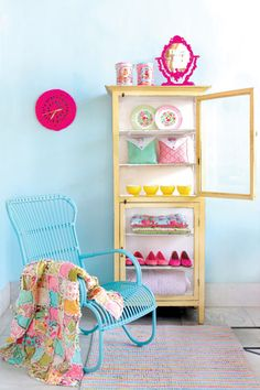 colourful cabinet with cotton candy tins on top, from Lark