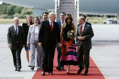 Hamburg Mayor Olaf Scholz walked the president and first lady down a red carpet and off th...
