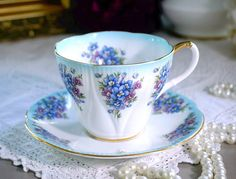 Royal Albert EMILY English Tea Cup and Saucer, Dainty Dina Series, Turquoise Blue Floral Teacup Set, Bone China, Made in England, 1960s