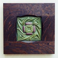 stylized thistles, love the tile - crazy for the frame!