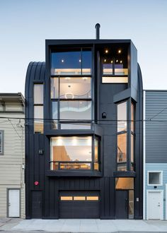 House Exterior Colors – 14 Modern Black Houses From Around The World | Two apartments are housed in this striking building with an all black facade.