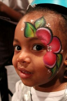 flower on side of face...cute because it is one giant flower :)