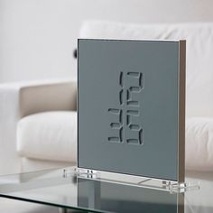 The @etchclock's magical display looks like it was carved from stone, but is made of an elastic membrane, erasing time in an instant.