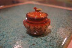 Jane Graber, IGMA artisan - redware covered casserole with bird handle