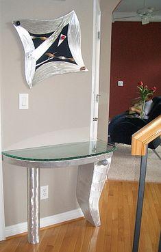 Modern foyer table in brushed aluminum by Tony Viscardi