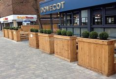 See how the owner of this commercial place has adorned it, isn't it looking amazing? You will amaze to know that the pallets are used for the creation of these planters and no one can say that they are not created by the experts.