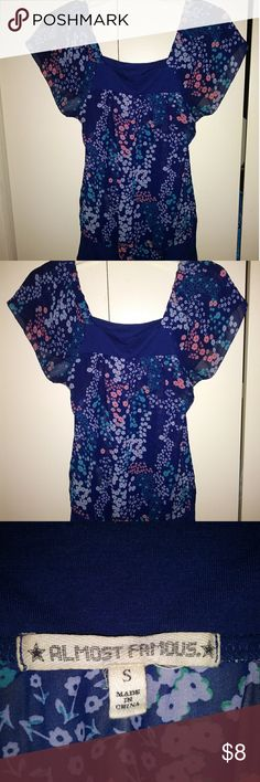 Almost Famous Blouse Blue flowery sheer blouse by Almost Famous. Like new. Almost Famous Tops Blouses