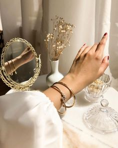 gold mirror and accessories with puffed white sleeve on blouse. glass fixtures and milk glass vase. bracelets and painted nails. Classy Aesthetic, Beige Aesthetic, Aesthetic Vintage, Aesthetic Photo, Aesthetic Pictures, Angel Aesthetic, Aesthetic Bedroom, Jewelry Photography, Belle Photo