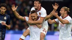 Roma go to the top of Serie A with Totti scoring in a 3-0 win over Inter Milan.