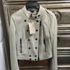 Burberry Brit Fur Shealing Jacket It still has tags attached. Size us 6 which is equivalent to a size small. Never got a chance to wear because it's too big on me (I'm a true xs). Sold out, a rare piece. See additional pictures in separate listing in closet. Has soft fur on the inside, 100% lamb shearling. Bought at Nordstrom, so authentic as always. Retails $1,995. A slight blemish shown in the last pic but is not very noticeable and could probably be removed by a professional. Burberry…