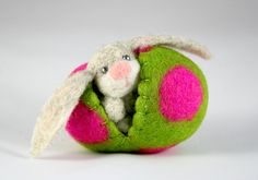 The cutest felted Easter bunny in a colorful egg. Perfect miniature Easter decoration and child friendly Easter toy. Natural, eco friendly toy made in