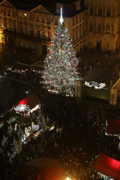 Prague, Czech Republic    Located in the famous christmas market in Old Town Square, Prague's grand Christmas tree stands as the festive centrepiece towering above the wooden stands which offer traditional cuisine and hand crafted goods, Prague, Czech Republic / Rex Features