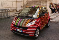 this is so cool a smart car totally covered in crocheted yarn