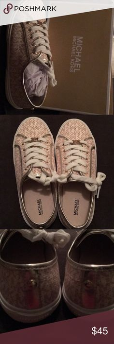New in box, never worn Michael Kors shoes Cute gold and cream MK logo casual sneakers. Brand new in box, never worn.  Kids size 5, about equal to women's 6.  (Euro size 36) Michael Kors Shoes Sneakers