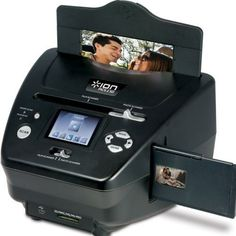 Ion Audio Photo  Slide  and Film Scanner (PICS2SD): http://www.amazon.com/Audio-Photo-Slide-Scanner-PICS2SD/dp/B0038WJXIM/?tag=cheap136203-20