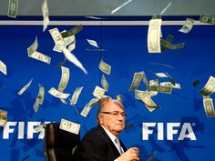 A protester threw a stack of fake money at FIFA president Sepp Blatter during a press conference
