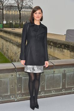 Paris Fashion Week : Marion Cotillard looked picture-perfect in a structured black coat and matching pumps, complete with a brilliant blue manicure, while arriving to the Christian Dior show during PFW.