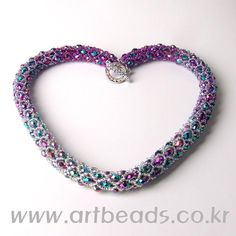 This site is AMAZING and so stunning, especially if you are a beading or cross stitch enthusiast!  It's in Russian, but there are charts for practically everything!
