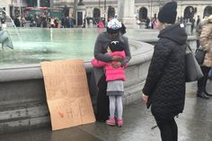 'I am a Muslim not a terrorist': Blindfolded Muslim teenager gives out hugs in Trafalgar Square