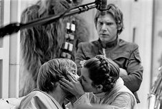 Harrison Ford watching Mark Hamill and Carrie Fisher kiss on the set of The Empire Strikes Back (1980)