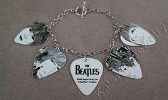 Beatles Revolver album art on guitar picks on a charm bracelet = awesome.
