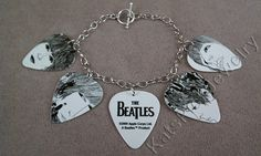 Beatles Revolver album art on guitar picks on a charm bracelet = awesome.