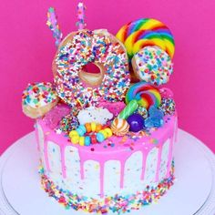 My birthday is coming up on January and I'm sooo craving birthday cake now! This cake is amaze balls! Torta Candy, Candy Cakes, Cupcake Cakes, Donut Cakes, Donut Birthday Parties, Donut Birthday Cakes, Lol Birthday Cake, Rainbow Birthday Cakes, Amazing Birthday Cakes