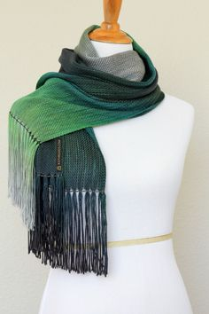 """Hand woven scarf with gradually changing colors from green to silver grey. Amazing color shades and color variety. Measures: L: 78"""" with 6"""" fringe on both ends W: 11"""" Care ... #kgthreads #accessories #cozy #fall #fashion #gift #gradient #peacock #unisex #women #wrap"""