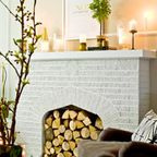 Fill the hearth with timber, candles, greenery.