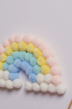 Check out our pom pom rainbow tutorial, and discover how to make this dreamy piece of DIY home decor yourself - perfect for adding beuaty to bedrooms, nurseries and other indoor spaces!