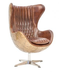 With a nod to the iconic Egg Chair of 1956, our version is inspired by the fighter planes of World War II. Aerodynamic curves that are aluminium wrapped provide a swept back sense of speed and the exhiliration of flight. Swathed in the luxury of vintage style leather it merges substance with style.