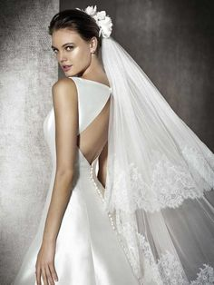 Elegant A-line wedding dress in mikado. Bodice with an off-the-shoulder neckline. Back with a geometric opening in the center. Pronovias Wedding Dress, Wedding Dress Necklines, Stunning Wedding Dresses, Blue Wedding Dresses, Designer Wedding Dresses, Wedding Attire, Bridal Dresses, Wedding Gowns, Halter Dresses