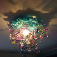 Light fixture from recycled water bottles by 7 Upcycled DIY Ideas to Decorate a Tween or Teen Girls Bedroom
