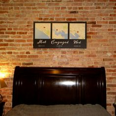 Three map canvas hung over the bed - perfect anniversary gift idea!!